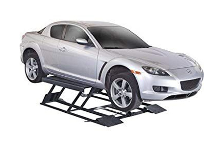 A car suspended on a portable car lift